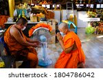 Small photo of Bangkok, Thailand 25/3/2020 Respect of monks in Thailand between monks who were ordained first and ordained after they were ordained during the time of communicable disease.