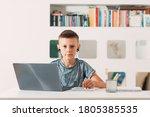 Young Boy In Headset Sitting At ...
