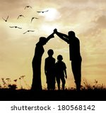 Family parents and children, secure and protecting home concept - stock photo