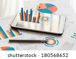 financial charts on the table... | Shutterstock . vector #180568652