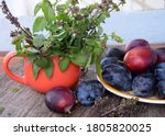 Plate Of Plums And An Orange...