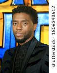 Small photo of London, United Kingdom - February 08, 2018: Chadwick Boseman attends the European Premiere of 'Black Panther' at Eventim Apollo in London, UK.