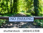 A No Parking Sign In A Woodlan...