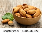 Almonds In Wooden Bowl On Old...