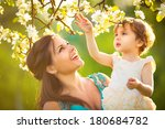 happy woman and child in the... | Shutterstock . vector #180684782
