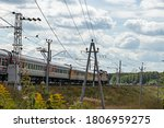 An Electric Train Goes By Rail...