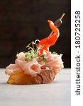tapas on crusty bread  | Shutterstock . vector #180725258