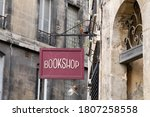 Small photo of bookshop sign on steel plate vintage signage of bookstore in city street in ancient european city