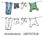 Stock vector hanging clothes on washing line color and outline vector illustration 180747518