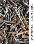 Heap Of Old Rusty Screws As A...