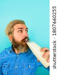 Small photo of Milk products. Man drinking milk. Man with bottle of milk. Lactose free milk. Bearded man drinking.