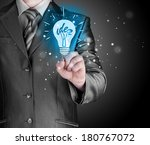 business man touching light of... | Shutterstock . vector #180767072