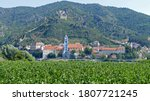 Cityscape of Durnstein in Wachau valley in Austria as seen from the other side of river Danube