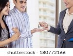 Small photo of Couple receives a key to their new apartment
