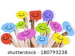 hands holding smiley faces... | Shutterstock . vector #180793238