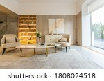 Small photo of modern interior design of the living area in the studio apartment in warm soft colors. decorative built-in lighting and soft beige furniture