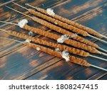 Bulrush Plant On A Wooden Tabl...