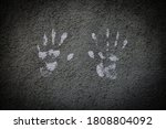 White Hand Prints On A Cement...