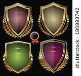 golden shield design set with... | Shutterstock .eps vector #180883742