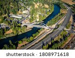 Small photo of An aerial view of the steel arch bridge over the Rogue River in the city of Rogue River Oregon