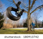 Child On Tire Swing. Wide Angle ...