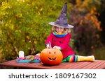 Child Carving Halloween Pumpki...