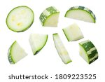 Small photo of Zucchini slices isolated on a white background, top view. Sliced zucchini, courgette isolated on white. Pieces of zucchini, top view. Diced zucchini, closeup. Set of pieces of courgette.