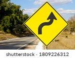 Warning traffic sign of a sharp ...