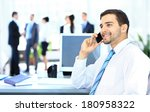 businessman talking on the phone | Shutterstock . vector #180958322