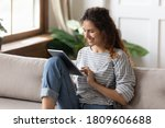 Woman Sit On Sofa Use Tablet...