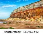 fallen rocks onto beach from... | Shutterstock . vector #180963542