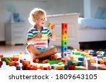 Child Playing With Colorful Toy ...
