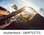Heavy Machinery Moving Earth...
