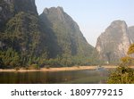 A Boat On The Li River Between...