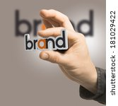 one hand holding the word brand ... | Shutterstock . vector #181029422