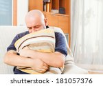 adult unhappy man sitting on... | Shutterstock . vector #181057376