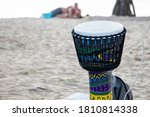 A Man Plays An African Djembe...