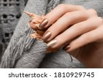 Female Hand With Gold Nail...