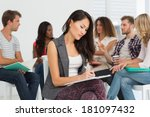 woman taking notes while... | Shutterstock . vector #181097432