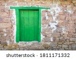 Green Door And Stone Wall In...