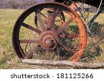 Rusted Iron Wheel On A Field