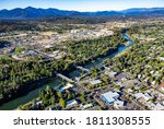 Small photo of Aerial view of downtown Grants Pass with the Caveman concrete arch bridge and the 7th street bridge crossing the Rogue River