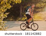 young man sitting on bike | Shutterstock . vector #181142882