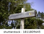 Wooden Sign On The Path Of...