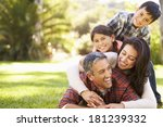 family lying on grass in... | Shutterstock . vector #181239332