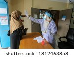 Small photo of Palestinians receive treatment at a UNRWA health center run by the UN during a closure amid an outbreak of the Coronavirus (COVID-19) in Rafah, in the southern Gaza Strip, on Sep 10, 2020.