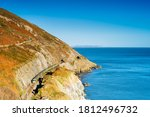 Train exiting a tunnel. View from Cliff Walk Bray to Greystones with beautiful coastline, cliffs and sea, Ireland
