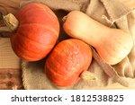Three Ripe Organic Pumpkins On...
