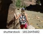 Young Woman Hiking Through The...