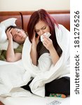 Small photo of Young ailing couple in their bedroom, vertical
